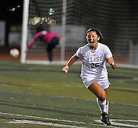 Aliso Niguel's Sarah Roberts celebrates after kicking the winning goal with only minutes left in the game against the team from Chino Hills.