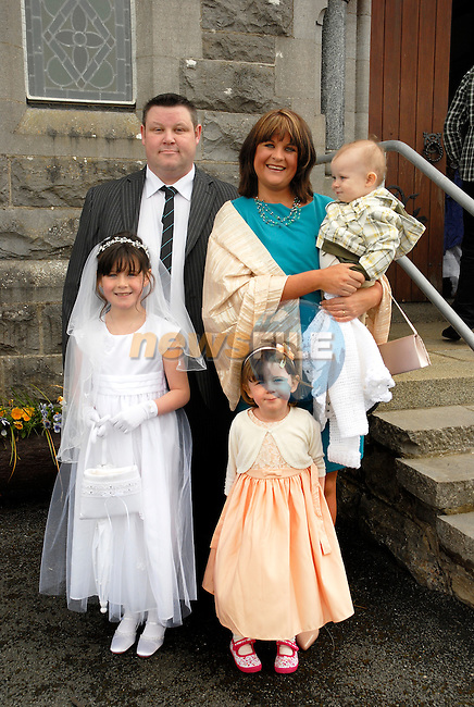 Ciara Coombes who made her First Holy Communion on Saturday at Tullyallen Church withher parents Colin and Susan, sister Sarah (3) and brother Matthew (1).