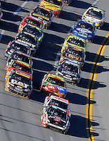 Nov. 1, 2009; Talladega, AL, USA; NASCAR Sprint Cup Series driver Robby Gordon leads the field during the Amp Energy 500 at the Talladega Superspeedway. Mandatory Credit: Mark J. Rebilas-