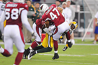 Aug. 28, 2009; Glendale, AZ, USA; Green Bay Packers wide receiver Greg Jennings is hit by Arizona Cardinals safety (47) Aaron Francisco during a preseason game at University of Phoenix Stadium. Mandatory Credit: Mark J. Rebilas-