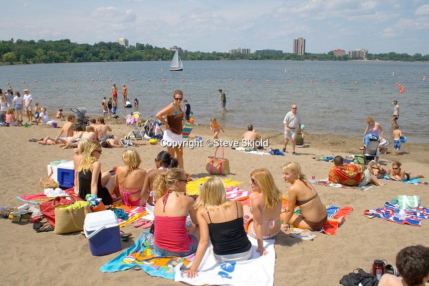 Group of teenage girls sunbathing at Thomas Beach on Lake Calhoun. Aquatennial Beach Bash Minneapolis Minnesota USA
