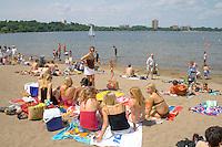 Group of teenage girls sunbathing at Thomas Beach on Lake Calhoun. Aquatennial Beach Bash Minneapolis Minnesota USA