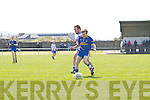 Spa's Eoin Cronin and St Mary's Keith Curran do battle up the sideline.