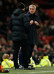 Tottenham Hotspur's Manager Jose Mourinho (C) talks with Fourth official Stuart Attwell (L) during the Premier League match at Old Trafford, Manchester. Picture date: 4th December 2019. Picture credit should read: Darren Staples/Sportimage