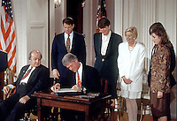 United States President Bill Clinton signs the &quot;Brady Bill&quot; during a  ceremony in the East Room of the White House in Washington, D.C. on November 30, 1993.  From left to right: Former White House press secretary James S. Brady; U.S. Vice President Al Gore; President Clinton; U.S. Attorney General Janet Reno; Sarah Brady, wife of James Brady; and Melanie Musick, whose husband was killed by a hand gun.  Brady passed away on Monday, August 4, 2014.<br /> Credit: Ron Sachs / CNP /MediaPunch