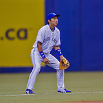 4 April 2015: Toronto Blue Jays infielder Munenori Kawasaki in action against the Cincinnati Reds at Olympic Stadium in Montreal, Quebec, Canada. The Blue Jays defeated the Reds 9-1 in the second of two MLB weekend exhibition games. The series marked the first time since 2004 that the Reds played at Olympic Stadium, during the last season of the Montreal Expos. Mandatory Credit: Ed Wolfstein Photo *** RAW (NEF) Image File Available ***