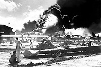 Captured Japanese photograph taken during the attack on Pearl Harbor, December 7, 1941.  In the distance, the smoke rises from Hickam Field.  (Navy)<br /> NARA FILE #:  080-G-19948<br /> WAR &amp; CONFLICT BOOK #:  1134