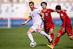 Ehsan Haji Safi of Iran (L) battles for the ball with Nguyen Cong Phuong of Vietnam (C) during the AFC Asian Cup UAE 2019 Group D match between Vietnam (VIE) and I.R. Iran (IRN) at Al Nahyan Stadium on 12 January 2019 in Abu Dhabi, United Arab Emirates. Photo by Marcio Rodrigo Machado / Power Sport Images