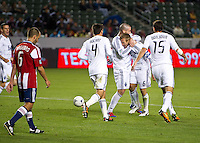 CARSON, CA - March 17, 2012: Vancouver Whitecaps FC players congratulating defender Jay DeMerit (6) who scored the game winning goal during the Chivas USA vs Vancouver Whitecaps FC match at the Home Depot Center in Carson, California. Final score Vancouver Whitecaps 1, Chivas USA 0.