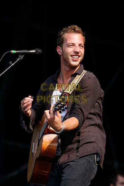 JAMES MORRISON.Performs at Hyde Park Calling - Day 2, London, England, UK, 26th June 2010..live music gig on stage festival concert.half length guitar playing microphone black shirt .CAP/MAR.©Martin Harris/Capital Pictures.