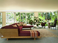 The bespoke sofa was designed by Carlos Miele and built with pequi wood, an oily and highly textured  Brazilian resource