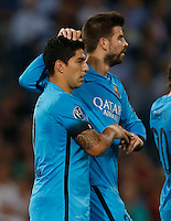 Barcellona's Luis Suarez celebrates after scoring during the Champions League Group E soccer match against AS Roma   at the Olympic Stadium in Rome September 16, 2015
