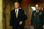 United States President George W. Bush  walks towards the door of Walter Reed Army Medical Center in Washington DC on July 1, 2005  after visiting soldiers injured during  Operation Iraqi Freedom. On right is Major General Kenneth L  Farmer Jr. <br /> Credit: Dennis Brack - Pool via CNP