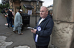 A pro-independence activist waiting to talk to voters outside a polling station in Shawlands, Glasgow on the day of the independence referendum. Yes Scotland were campaigning for the country to leave the United Kingdom, whilst Better Together were campaigning for Scotland to remain in the UK. On the 18th of September 2014, the people of Scotland voted in a referendum to decide whether the country's union with England should continue or Scotland should become an independent nation once again and leave the United Kingdom.