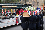 © Joel Goodman - 07973 332324 . 02/09/2013 . Bury , UK . Stephen Hunt's coffin is carried off a vintage fire truck and in to the church .  The funeral of fireman Stephen Hunt at Bury Parish Church today (Tuesday 3rd September 2013) . Stephen Hunt died whilst tackling a blaze at Paul's Hair World in Manchester City Centre in July 2013 . Photo credit : Joel Goodman