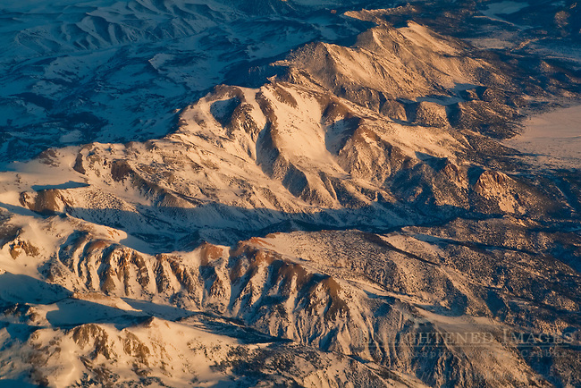 Aerial over snow-covered mountains in wither, Sierra Nevada, California