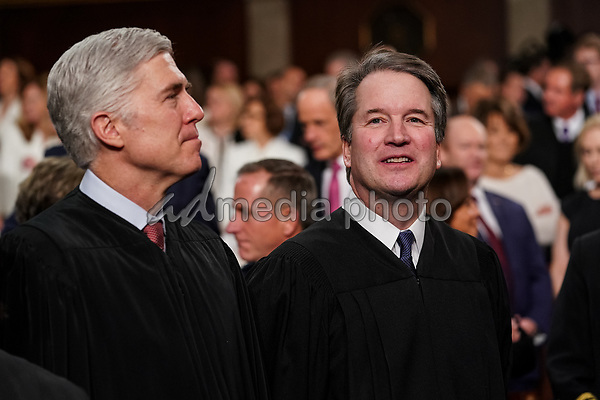 FEBRUARY 5, 2019 - WASHINGTON, DC: Supreme Court  Neil Gorsuch, left, and Brett Kavanaugh at the Capitol in Washington, DC on February 5, 2019. <br /> Credit: Doug Mills / Pool, via CNP