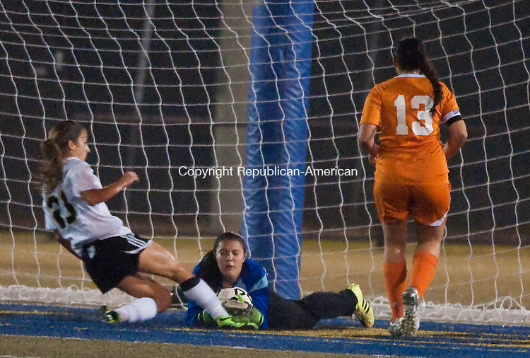 WATERBURY, CT--- -110515JS03--Watertown's Emily Hill dives to stop a shot by Woodland's Jessica Rodrigues (23) as Watertown's Julianna Rinaldi (13) looks on during their NVL  Girls Soccer Tournament final Thursday at Municipal Stadium in Waterbury. <br /> Jim Shannon Republican-American