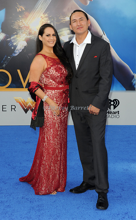 Eugene Brave Rock and date arriving at the Los Angeles world premiere of Wonder Women, held at the Pantages Theatre Hollywood, California on May 25, 2017