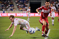 Dax McCarty (11) of the New York Red Bulls goes down from a challenge by Gonzalo Segares (13) of the Chicago Fire. The New York Red Bulls and the Chicago Fire played to a 2-2 tie during a Major League Soccer (MLS) match at Red Bull Arena in Harrison, NJ, on August 13, 2011.