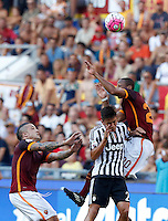 Calcio, Serie A: Roma vs Juventus. Roma, stadio Olimpico, 30 agosto 2015.<br /> Roma&rsquo;s Seydou Keita, top right, jumps over Juventus&rsquo; Paulo Dybala as Roma&rsquo;s Radja Nainggolan, left, looks on during the Italian Serie A football match between Roma and Juventus at Rome's Olympic stadium, 30 August 2015.<br /> UPDATE IMAGES PRESS/Riccardo De Luca