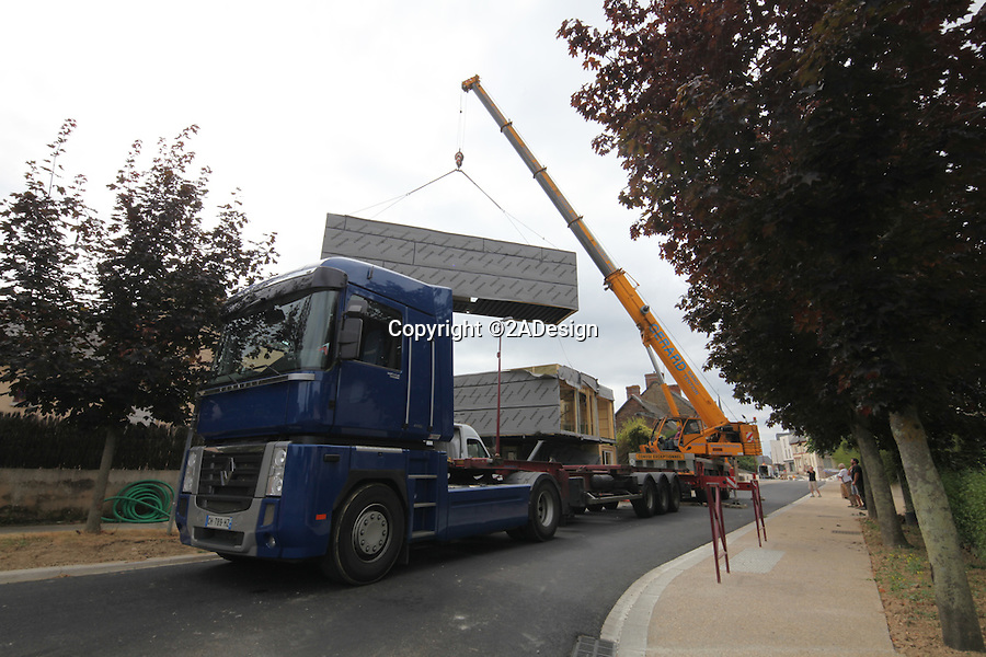 BNPS.co.uk (01202 558833)<br /> Pic: 2ADesign/BNPS<br /> <br /> The shipping containers being delivered.<br /> <br /> Ultra-modern family home built for just £125,000.<br /> <br /> An architect has constructed an super cool family home out of shipping containers for the cost of a bedsit flat.<br /> <br /> The 'Flying Box' house is the creation of  Josué Gillet who built the family home as a result of his limited space and budget and lives there with his wife and young son. <br /> <br /> The revolutionary structure near Rennes in north west France uniquely incorporates five 'high cube' shipping containers - an extra-large variant of the transportation device that measures 40ft long.
