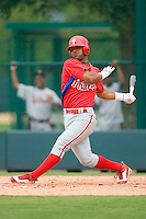 Jonathan Villan #82 of the GCL Phillies follows through on his swing versus the GCL Braves at Disney's Wide World of Sports Complex, July 13, 2009, in Orlando, Florida.  (Photo by Brian Westerholt / Four Seam Images)