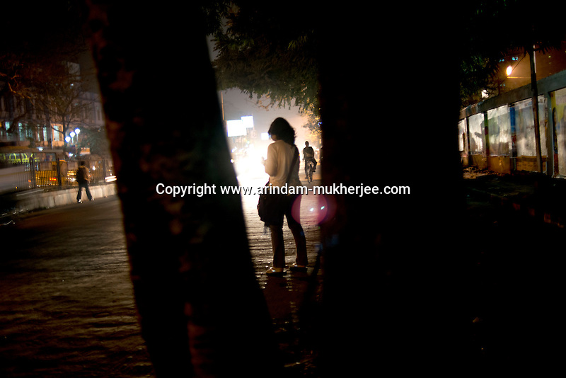 A woman waiting for transport in late evening in Kolkata, India. According to the cases registered, a large number of sexual assaults take place in such poorly lit stretches, making it unsafe for women. Crimes against women have been going on since centuries. In India, women have been categorically marginalized with various types of repressions enforced upon them. Be it home or outside, an Indian woman is potentially at the risk of being discriminated against, molested, raped and even killed. Until recently, turning a blind eye to such crimes has been the norm in largely gender-biased Indian society. But after the brutal gang rape and subsequent death of the Delhi Physiotherapy student, the so-far-silent middle class has turned vocal. ..