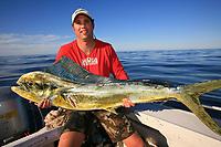 angler and Mahi mahi, dorado or dolphin fish, Coryphaena hippurus, sportfishing
