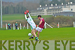 Dromid's Aidan O'Connor gets the shot away but misses his target in very windy conditions as Kanturk's Shane Walsh carries out his duties in defence.