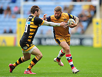 Chris Brooker of Bristol Rugby fends Elliot Daly of Wasps. Aviva Premiership match, between Wasps and Bristol Rugby on September 18, 2016 at the Ricoh Arena in Coventry, England. Photo by: Patrick Khachfe / JMP