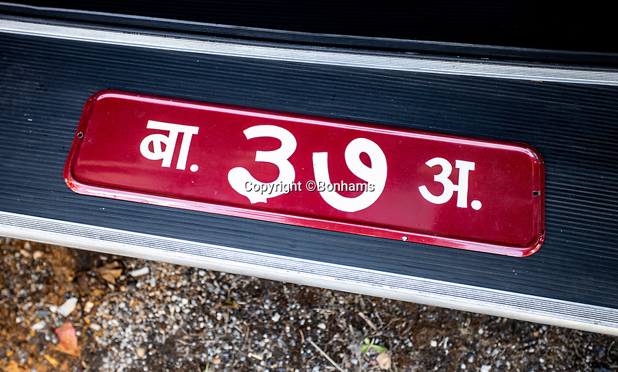 BNPS.co.uk (01202 558833)<br /> Pic: Bonhams/BNPS<br /> <br /> The Nepalese number plate comes with the car.<br /> <br /> A Maharaja's motor which was carried hundreds of miles across the Himalayas to him has emerged for sale for £40,000.<br /> <br /> The 1926 Crossley's first owner was Maharaja Juddha Shamsher Jang Bahadur Rana, who had it shipped out from the manufacturer's Manchester factory to exotic Calcutta in India.<br /> <br /> Since there was only two miles of road which could be driven in Nepal, the classic car was carried over the mountainous landscape by his unfortunate porters.<br /> <br /> It was used by successive Rana family rulers, who styled themselves as 'heriditary Prime Ministers of Nepal', before leaving the country in 1968, finding a new home in Salt Lake City, US.<br /> <br /> This burgundy model, the 20.9HP Canberra Landaulette, is believed to be the only surviving example of its type in the world. It is going under the hammer with auction house Bonhams, of London.
