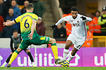 Lys Mousset (r) of Sheffield United runs at Christopher Zimmermann of Norwich City during the Premier League match at Carrow Road, Norwich. Picture date: 8th December 2019. Picture credit should read: James Wilson/Sportimage