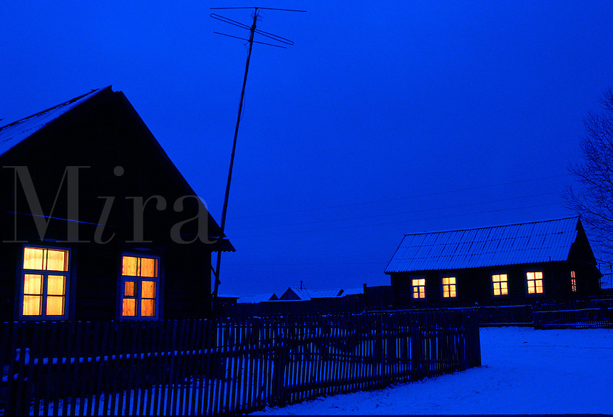 Rural houses on winter night..