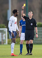 Christian Maghoma is shown the yellow card by Referee Alan Dale during the U23 - Premier League 2 match between Tottenham Hotspur U23 and Everton at Tottenham Training Ground, Hotspur Way, England on 15 January 2018. Photo by Vince  Mignott / PRiME Media Images.