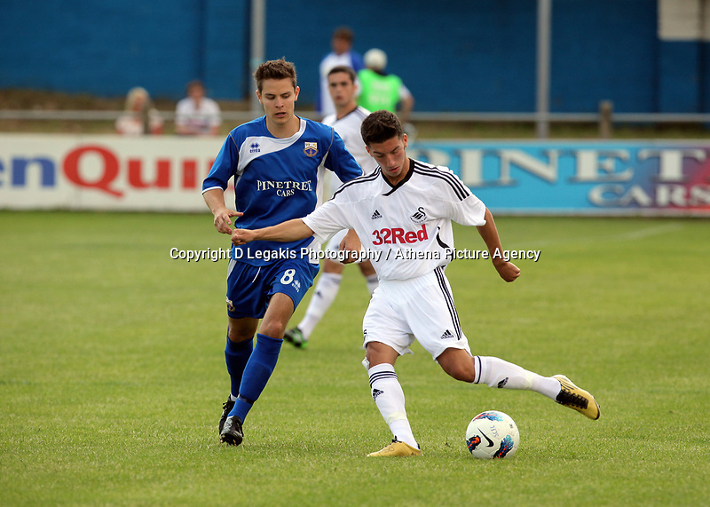 Pictured: Lee Lucas of Swansea (R) marked by Matthew Thompson of Port Talbot (L). Saturday 17 July 2011<br />