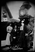 Two women and a man posing on pilot of RGS engine with diamond stack.<br /> RGS  Ridgway, CO  ca. 1900