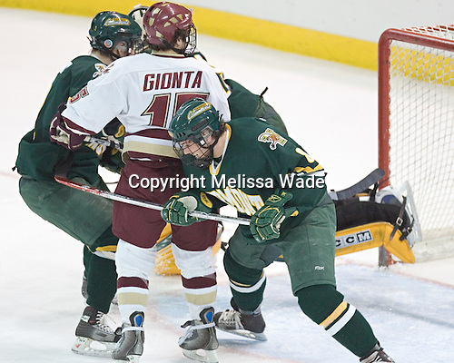 Stephen Gionta watches Brian Boyle's shot go in - The Boston College Eagles completed a shutout sweep of the University of Vermont Catamounts on Saturday, January 21, 2006 by defeating Vermont 3-0 at Conte Forum in Chestnut Hill, MA.