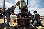 LA MESA, NM - APRIL 10, 2015:  Skip Potts, left, and Lupe Guillen, right, work to repair a partially collapsed well on Phil Archer's farm. Archer will have to replace the well soon, one of two on his farm. CREDIT: Max Whittaker for The New York Times