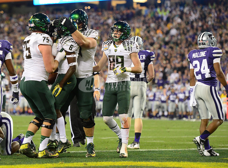 Jan. 3, 2013; Glendale, AZ, USA: Oregon Ducks running back De'Anthony Thomas (6) is congratulated by teammates after running for a touchdown in the first quarter against the Kansas State Wildcats during the 2013 Fiesta Bowl at University of Phoenix Stadium. Mandatory Credit: Mark J. Rebilas-