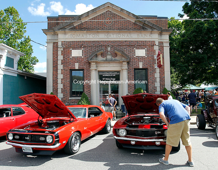 Waterbury, CT-09 September 2012-090912CM07- Andy Laza of Dallas, TX checks out the engine of a 1969 Chevy Camero Z/28, owned by Mark Pfeffer of Northfield during the Thomaston Police Department's 21st annual car show Sunday morning in Thomaston.  The Main Street Cruise, which annually draws hundreds of cars, is the largest fundraiser for the Thomaston Police Explorer's program.   Christopher Massa Republican-American