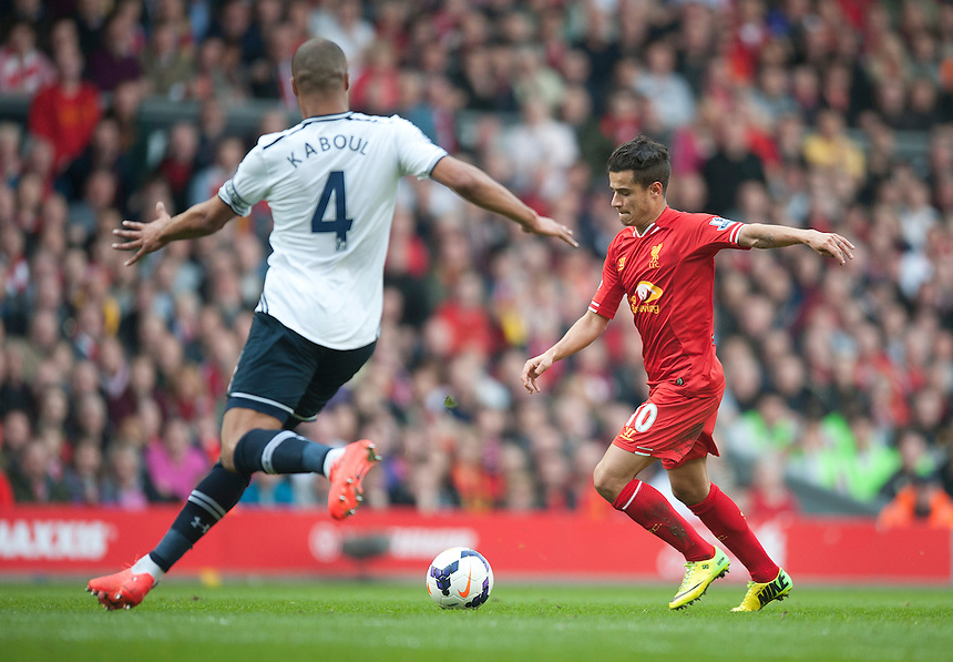 Liverpool's Philippe Coutinho scores his sides third goal shooting past Tottenham Hotspur's Younes Kaboul<br /> <br /> Photo by Stephen White/CameraSport<br /> <br /> Football - Barclays Premiership - Liverpool v Tottenham Hotspur - Sunday 30th March 2014 - Anfield - Liverpool<br /> <br /> &copy; CameraSport - 43 Linden Ave. Countesthorpe. Leicester. England. LE8 5PG - Tel: +44 (0) 116 277 4147 - admin@camerasport.com - www.camerasport.com