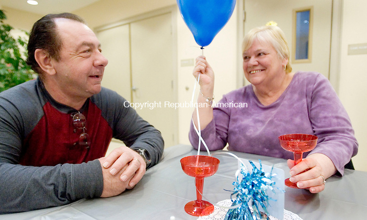 COUNTRYLIFE USE ONLY<br /> OXFORD CT. 08 December 2014-010815SV06-Rich and Pat Gramigna of Shelton enjoy the New Year party at the Oxford Senior Center in Oxford Thursday. <br /> Steven Valenti Republican-American