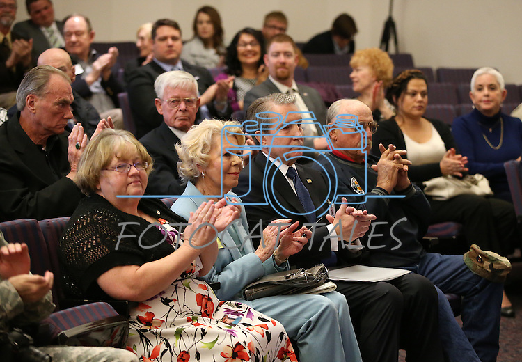 Approximately 50 people attend the opening ceremony of the Always Lost: A Meditation on War exhibit at the Legislative Building in Carson City, Nev., on Monday, April 6, 2015. <br />