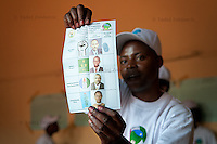 Election worker displays a ballot for the Rwandan presidential elections in a polling station in Kigali, Rwanda. The voter voted for president Paul Kagame. August 9 2010