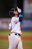 Tampa Yankees shortstop Gleyber Torres (11) points to the sky as he crosses the plate after hitting a home run during a game against the Daytona Tortugas on August 5, 2016 at George M. Steinbrenner Field in Tampa, Florida.  Tampa defeated Daytona 7-1.  (Mike Janes/Four Seam Images)