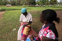 N. Uganda, Gulu District. Peter C. Alderman Foundation project.Alice Nora Kipwola, PCAF Trauma Counselor, assessing and counseling Christine Alum. Christine lost her arm during the war and struggles with depression. She has a son who helps her. Christine lives about an hour driving from the clinic and walks there for her monthly sessions.