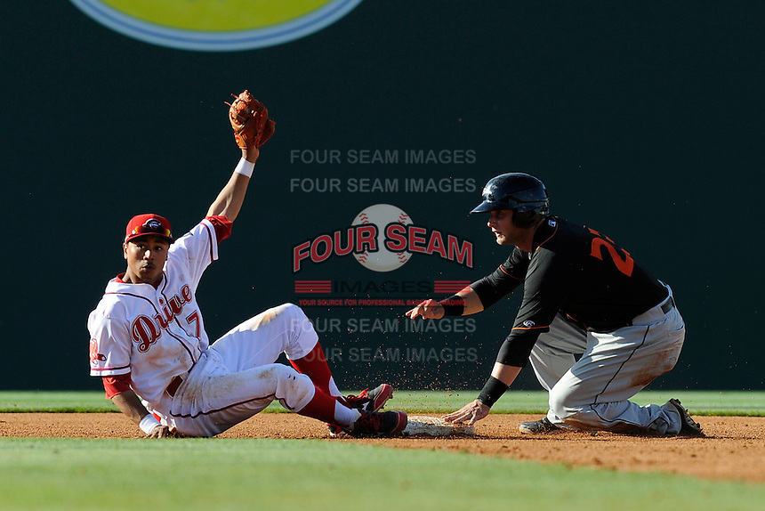 Shortstop Mookie Betts (7) of the Greenville Drive shows he still has the ball after tagging out Christian Walker (23) of the Delmarva Shorebirds, who was attempting to steal second base in a game on Monday, April 29, 2013, at Fluor Field at the West End in Greenville, South Carolina. Delmarva won, 6-5 in game one of a doubleheader. (Tom Priddy/Four Seam Images)