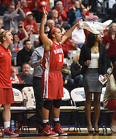 #31 Cherelle Moore celebrates on the Hartford bench after Deanna Mayza hit a three pointer in the second half.  Albany claimed the America East Championship for the forth year in a row with a 84-75 win over the Hawks.  Steve McLaughlin / Special to The Courant