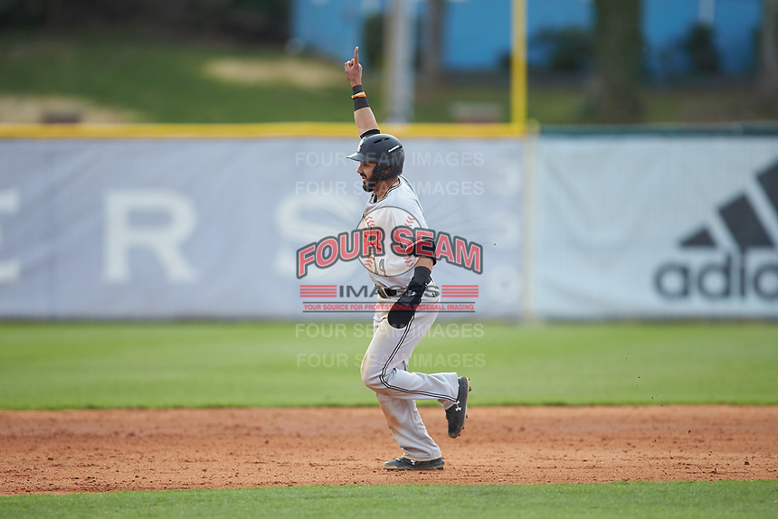 Luis Gimenez (14) of the Campbell Camels raises his finger in the air as he rounds the bases following a home run by teammate Spencer Packard (not pictured) during the game against the High Point Panthers at Williard Stadium on March 16, 2019 in  Winston-Salem, North Carolina. The Camels defeated the Panthers 13-8. (Brian Westerholt/Four Seam Images)